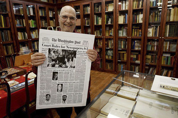 Frank Romano displays an historic front page from The Washington Post